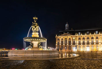 Fountain of three graces on the place de la bourse in Bordeaux at night in Gironde, New Aquitaine, France