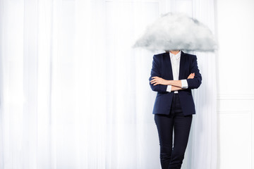 Business woman stand with head in cloud concept