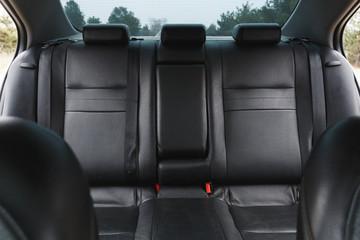 Car interior, part of back seats, close