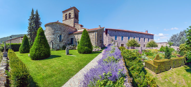 Panoramic view of Saint Victor church at left and the part of the castle from the garden. Saint Etienne metropole.