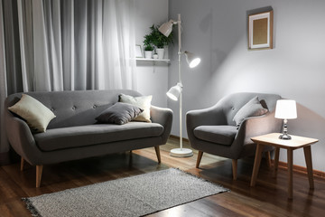 Stylish interior of living room at night Fototapete