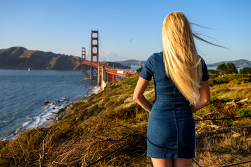 Strong wind at the Golden Gate Bridge blowing into her blond hair