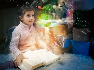 A girl reads. Concept-a fairy-tale world in a book for a child, children's imagination.
