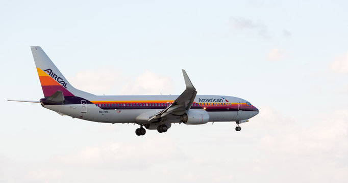 MIAMI, USA - March 6, 2017: An American Airlines Boeing 737 displaying the retro livery of Air Cal Airlines on final approach at the Miami International Airport.