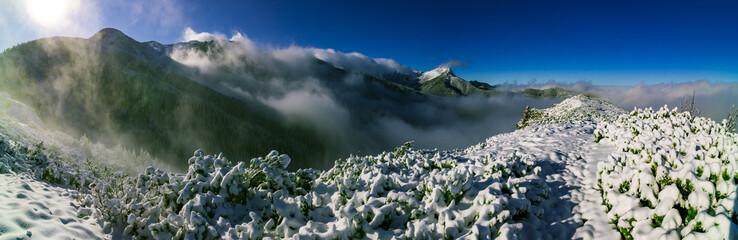 Giewont nad chmurami, zima - Tatry - fototapety na wymiar