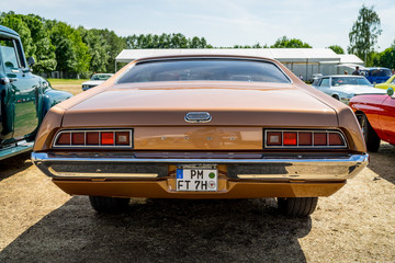 PAAREN IM GLIEN, GERMANY - MAY 19, 2018: Mid-size car Ford Torino 500, 1971. Rear view.