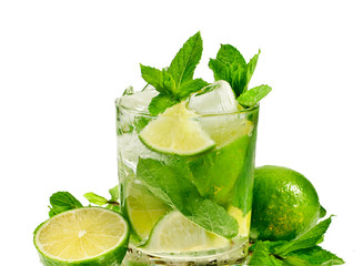 Cocktail mojito with mint leaves and limes isolated on a white background