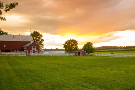 Typical Amish farm at sunset seen from Pennsylvania Dutch area