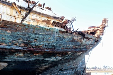 Acrylic Prints Shipwreck abandoned wrecked ship sitting on a trailer