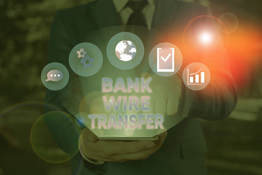 Conceptual hand writing showing Bank Wire Transfer. Concept meaning Electronic transfer of money through bank to bank