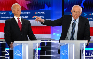 Democratic presidential candidate former Vice President Joe Biden bends back to avoid the hand of Senator Bernie Sanders as Sanders points past Biden during the U.S. Democratic presidential candidates debate at the Tyler Perry Studios in Atlanta