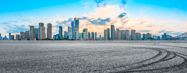 Sunset empty asphalt road and city skyline in Chongqing