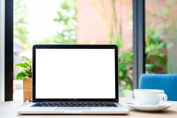 Mockup of laptop computer with empty screen with coffee cup on table of the coffee shop background,White screen