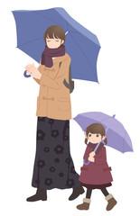 冬 傘をさして散歩する親子