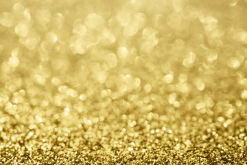 Abstract blur gold glitter sparkle defocused bokeh light background