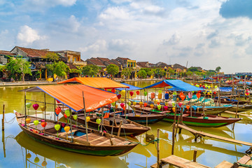 Wooden boats on the Thu Bon River in Hoi An , Vietnam