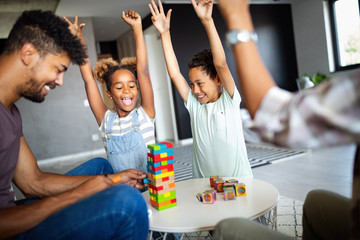 Happy black family having fun times at home