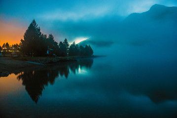 fog over a mountain lake before dawn.