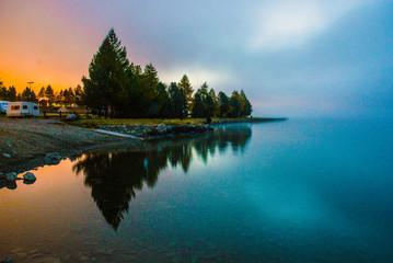 fog over a mountain lake before dawn.