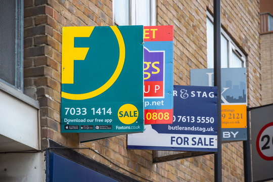 For sale real estate signs around Hoxton in east London