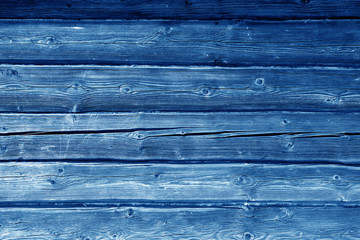 Old grungy wooden planks background in navy blue color.
