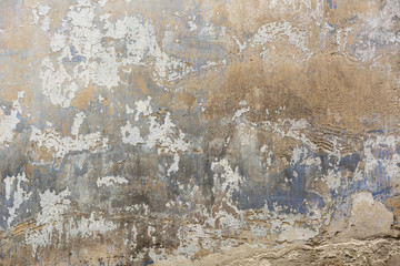 Background weathered grey concrete wall with peeled off paint