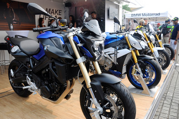 KUALA LUMPUR, MALAYSIA -JUNE 19, 2017: Big bike motorcycle display in huge showroom. Some of the motorcycle still in wrapping plastic to protect its body from scratch.