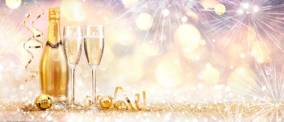 Wall Mural - New Year Celebration With Champagne And Fireworks - Golden Abstract Background
