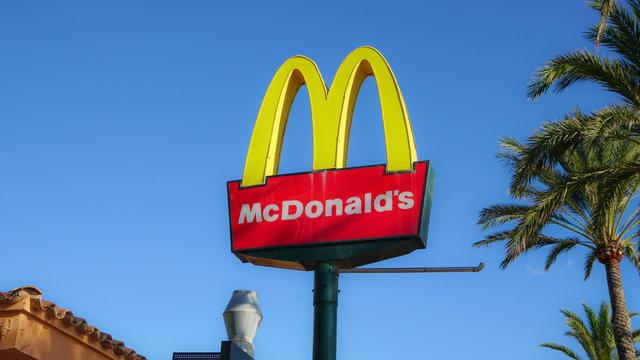 Palma de Mallorca, Spain - September 19, 2017.  McDonald's restaurant sign. McDonald's is the world's largest chain of hamburger fast food restaurants