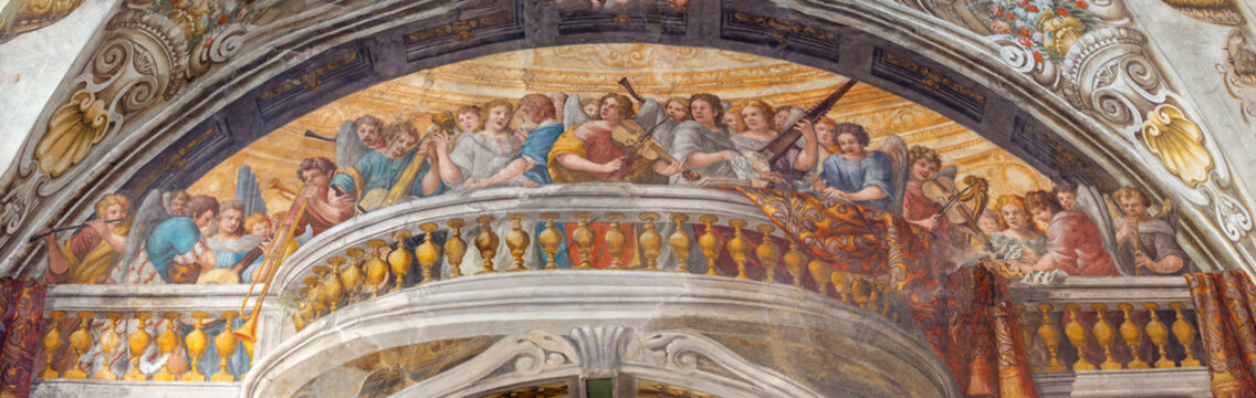 PARMA, ITALY - APRIL 16, 2018: The fresco of Choir of angels with the music instruments in church Chiesa di Santa Croce by Giovanni Maria Conti della Camera (1614 - 1670).