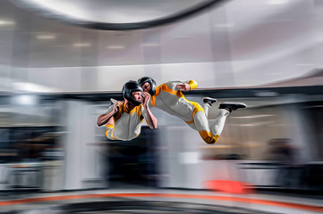 Extreme sports. Levitation in wind tunnel. Indoor sky diving. Team flyers. Yoga fly in wind tunnel. Indoor skydiving.