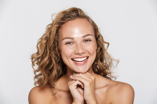 Image of happy half-naked woman laughing and looking at camera