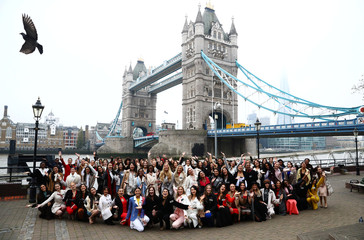 Miss World contestants pose for a photograph ahead of the 69th Miss World festival and final in London