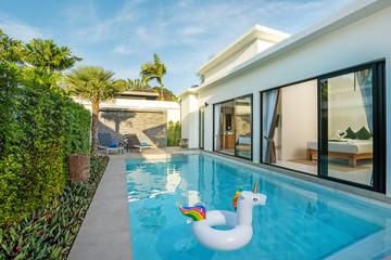Swiming pool in luxury pool villa with floating unicorn