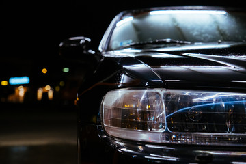 Fotobehang Snelle auto s Carwash night time black car and lamp illumination