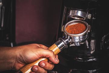 Barista grinding coffee