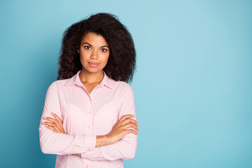 Photo of amazing wavy dark skin business lady crossing arms bossy self-confident look wear pink...