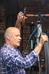 Mechanic servicing a bicycle in a workshop