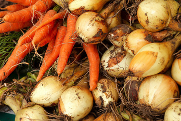 Carrots and Onions in a Market for Sale