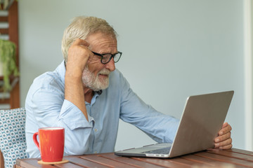 Portrait senior man using laptop for working at home, Freelance concept - Image