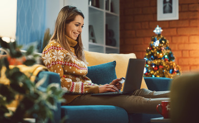 Happy woman doing online shopping at Christmas
