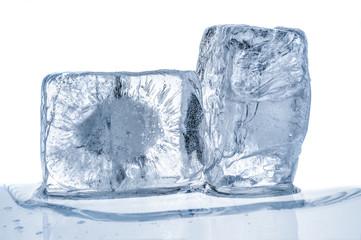 Melting blue ice cubes close up