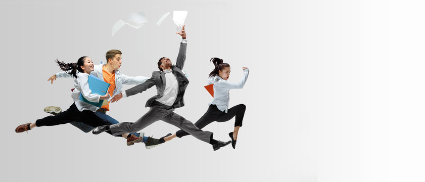 Happy office workers jumping and dancing in casual clothes or suit with folders on white. Ballet dancers. Business, start-up, working open-space, motion and action concept. Creative collage. Copyspace