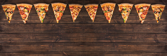 slices of tasty pepperoni pizza looking like christmas flags, creative holiday banner and concept of fast food on wooden background with copy space, top view