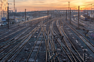 Foto auf Acrylglas Eisenbahnschienen complexe railway station at sunrise
