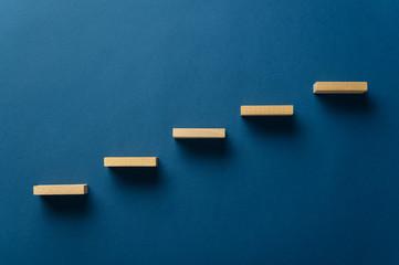 Wooden pegs forming a stairway Fotomurales