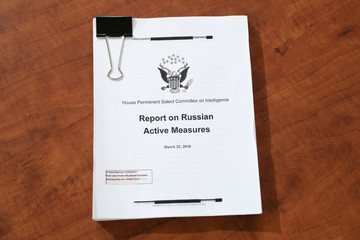 A copy of a report on Russian active measures lies on a desk at a House Intelligence Committee hearing as part of Trump impeachment inquiry on Capitol Hill in Washington