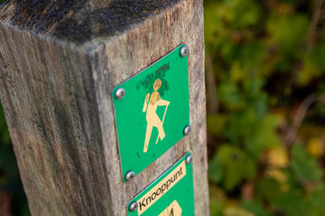walking hiker route sign. pedestrians follow this route for a great experience from the specific city or town.