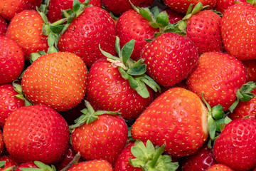 Fresh strawberry as background. Close up, top view, high resolution product.