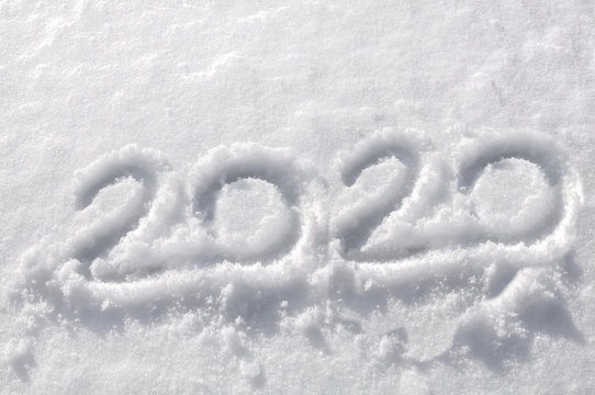 close on 2020 number handwritten in the snow